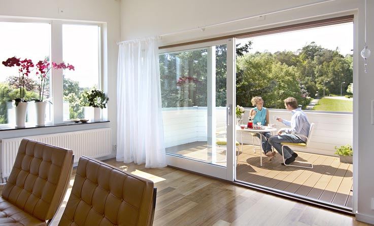 Make the most of the Summer weather with Swedish aluminium timber composite sliding doors